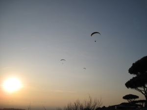 paragliders above the lake
