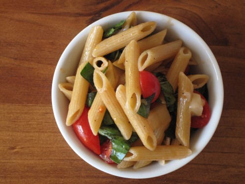 Penne, tomatoes, basil and cheese